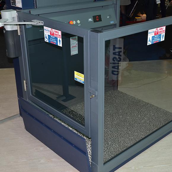 açık tip engelli asansörü